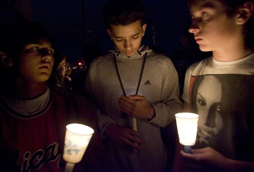 In this Thursday, Nov. 29, 2012 file photo, mourners hold candles as they stand on a pedestrian bridge during a vigil for a junior high school student who died in an apparent suicide on a pedestrian bridge near Bennion Junior High School in Taylorsville, Utah. A report released by the Centers for Disease Prevention and Control on Wednesday, Oct. 8, 2014 says although Americans are living longer than ever before - rates in 2012 are falling for most of the leading causes of death, with one exception of the still-climbing suicide rate which reached its highest point in 25 years. (AP Photo/The Salt Lake Tribune, Kim Raff)