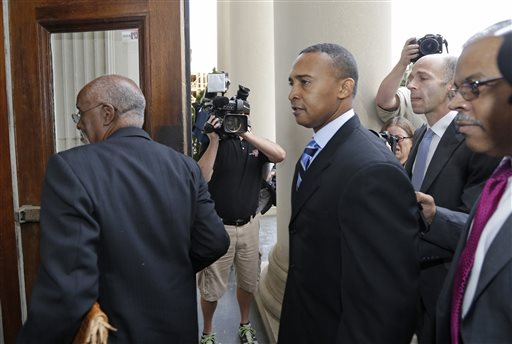 Former Charlotte Mayor Patrick Cannon arrives at the federal courthouse in Charlotte, N.C., Tuesday, Oct. 14, 2014, for sentencing in his corruption case. (AP Photo/Chuck Burton)