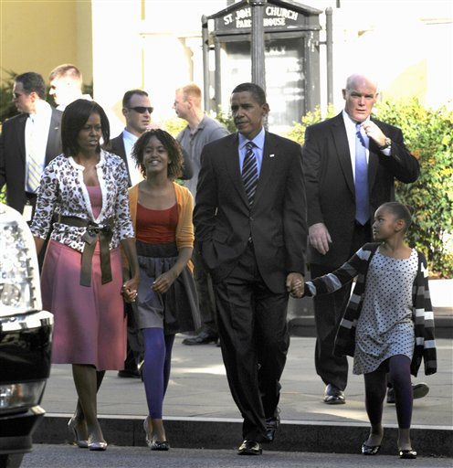 In this Oct. 11, 2009 file photo, Secret Service Agent Joseph Clancy, right, walks behind President Barack Obama, first lady Michelle Obama and their, children Sasha, right, and Malia, second from left, walk back to the White House after attending St. John's Episcopal Church in Washington. Secret Service Director Julia Pierson resigned Wednesday, a day after bitingly critical questioning by Congress about a White House security breach. There had been increasing calls for her departure during the day. Pierson will be replaced by Clancy, a former special agent in charge of the president's protective detail who retired in 2011. (AP Photo/Susan Walsh, File)