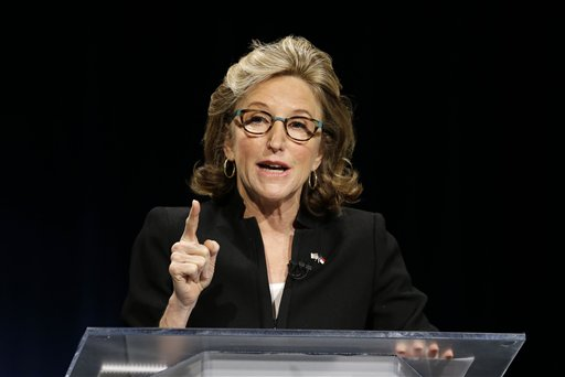 """In this Oct. 7, 2014, photo, Sen. Kay Hagan, D-N.C., makes a comment during a live televised debate with North Carolina Republican Senate candidate Thom Tillis at UNC-TV studios in Research Triangle Park, N.C. North Carolina's Senate race boils down to a battle of extremes. At least that's how Hagan and Tillis want voters to look at it. Running against President Barack Obama as much as he is against Hagan, Tillis calls the president's health care law an """"unworkable mess,"""" blasts American foreign policy as muddled and weak, and bemoans a $17 trillion-plus national debt. (AP Photo/Gerry Broome, Pool)"""