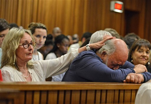 Reeva Steenkamp's father Barry Steenkamp, right, cries as he is comforted by his wife June, left, as they listen to proceedings during the third day of sentencing for Oscar Pistorius at the high court in Pretoria, South Africa, Wednesday, Oct. 15, 2014. Pistorius faces up to 15 years in prison after being convicted of culpable homicide, or negligent killing, for shooting Steenkamp, although he could also receive a suspended jail sentence and a fine. (AP Photo/Antoine de Ras, Pool)