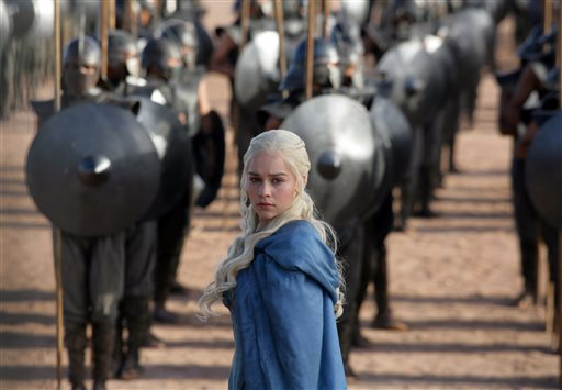"""This file publicity image released by HBO shows Emilia Clarke as Daenerys Targaryen in a scene from """"Game of Thrones.""""   HBO plans to offer a stand-alone version of its popular video-streaming service, CEO Richard Plepler said at an investor meeting at parent Time Warner Inc. on Wednesday, Oct. 15, 2014. (AP Photo/HBO, Keith Bernstein, File)"""