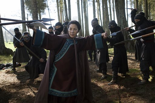 """In this image released by Netflix, Michelle Yeoh appears in a scene from""""Crouching Tiger, Hidden Dragon: The Green Legend,"""" which will premiere on Netflix and in selected global IMAX theaters on Aug. 28, 2015. (AP Photo/Netflix, Rico Torres)"""