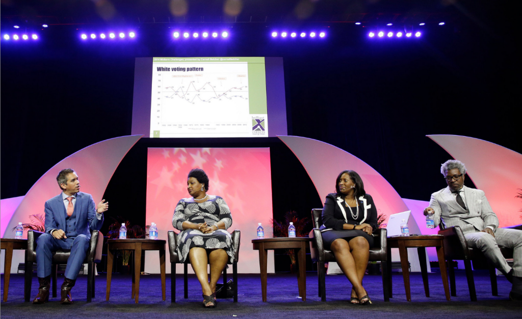 """The Democratic leader of the Georgia House, Stacey Abrams, second from left, denounced as """"voter suppression"""" the failure to process 40,000 new applications. (John Locher/Associated Press)"""