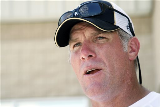In this July 30, 2012, file photo, former NFL quarterback Brett Favre speaks to the media in Hattiesburg, Miss. Favre says he couldn't be happier to see Peyton Manning on the brink of breaking his NFL record of 508 touchdown throws. Manning has 503 heading into Denver's road game Sunday, Oct. 12, 2014, against the New York Jets.  (AP Photo/Rogelio V. Solis, File)