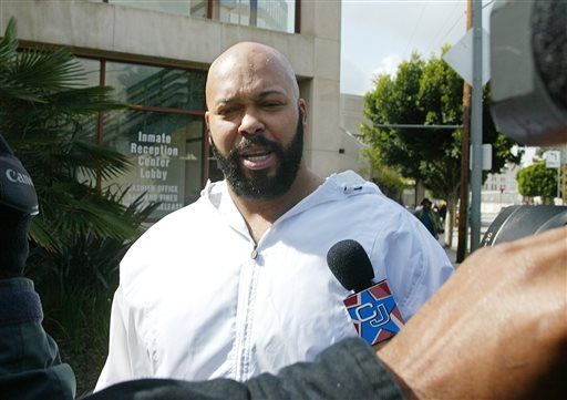 """In this Feb. 26, 2003 file photo, rap music mogul Marion """"Suge"""" Knight walks out of the Los Angeles County jail, in Los Angeles.  Los Angeles prosecutors say Knight and comedian Katt Williams were arrested and charged with one count of robbery on Wednesday, Oct. 29, 2014, after a paparazzo reported the men stole her camera in Beverly Hills on Sept. 5, 2014. (AP Photo/Damian Dovarganes, File)"""