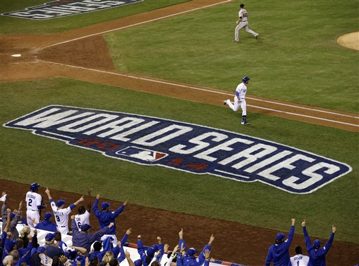 Kansas City Royals' Omar Infante after hitting a two-run home run during the sixth inning of Game 2 of baseball's World Series against the San Francisco Giants Wednesday, Oct. 22, 2014, in Kansas City, Mo. (AP Photo/Jeff Roberson)