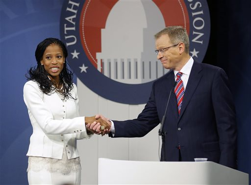 Republican Mia Love and Democrat Doug Owens greet following their second debate in their race for Utah's 4th Congressional District, Tuesday, Oct. 14, 2014, in Salt Lake City. The Tuesday night debate is the final one this year from the new Utah Debate Commission. (AP Photo/Rick Bowmer)