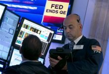 Photo of Fed Keeps Rate at Record Low, Ends Bond Buying