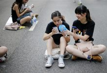 Photo of Firm Says Phone Apps Spy on Hong Kong Protesters