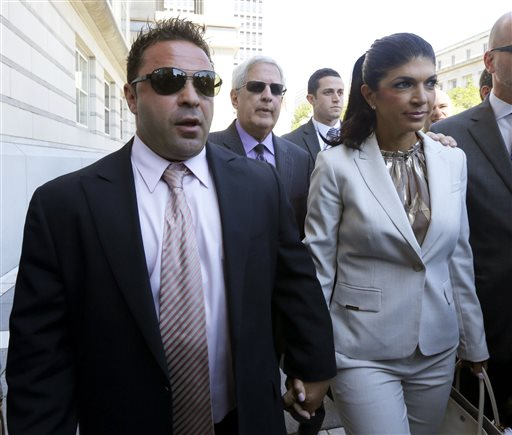"""In this July 30, 2013 file photo, """"The Real Housewives of New Jersey"""" stars Giuseppe """"Joe"""" Giudice, 43, left, and his wife, Teresa Giudice, 41, of Montville Township, N.J., walk out of Martin Luther King, Jr. Courthouse after an appearance in Newark, N.J. Teresa and Giuseppe """"Joe"""" Giudice are scheduled to be sentenced Thursday Oct. 2, 2014 on conspiracy and bankruptcy fraud charges in federal court in Newark. (AP Photo/Julio Cortez, File)"""