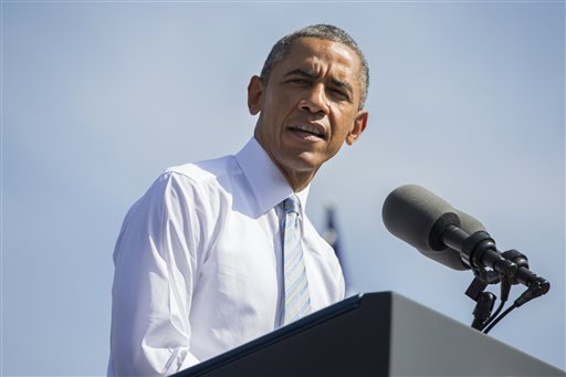 In this Oct. 10, 2014, file photo, President Barack Obama speaks at Frank G. Bonelli Regional Park in San Dimas, Calif. Democrats' high hopes of mitigating House losses in a rough election year have been dashed by reality. Obama's dismal approval ratings and midterm malaise have been a drag on Democrats. (AP Photo/Evan Vucci, File)