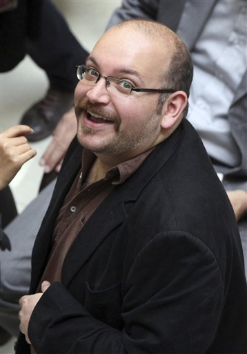 """In this photo April 11, 2013 file photo, Jason Rezaian, an Iranian-American correspondent for the Washington Post smiles as he attends a presidential campaign of President Hassan Rouhani in Tehran, Iran. The family of Rezaian jailed without charge in Iran is urging authorities in Tehran to release him, calling his incarceration a """"farce"""" 100 days after he was detained. (AP Photo/Vahid Salemi, File)"""