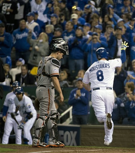 Kansas City Royals Mike Moustakas crosses home plate after hitting a solo home run off San Francisco Giants relief pitcher Hunter Strickland  in the bottom of the sixth inning of Game 6 of baseball's World Series Tuesday, Oct. 28, 2014, in Kansas City, Mo. (AP Photo/The Sacramento Bee, Jose Luis Villegas)