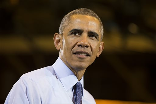 President Barack Obama speaks during a campaign rally for Wisconsin Democratic Gubernatorial candidate Mary Burke at North Division High School on Tuesday, Oct. 28, 2014, in Milwaukee. (AP Photo/Evan Vucci)