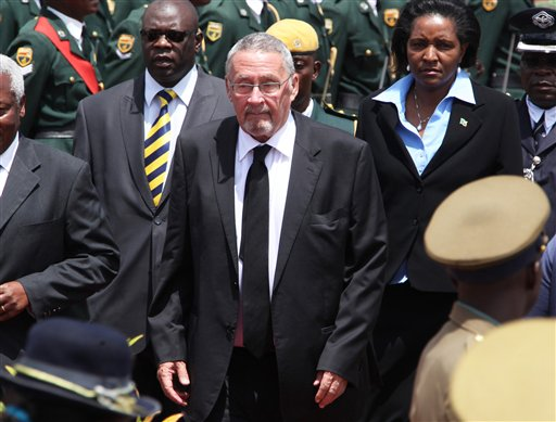 In this Monday, Jan 21, 2014 file photo Zambian deputy president Guy Scott, centre, attends the burial of Zimbabwe's deputy president John Nkomo, at the Heroes Acre, in Harare,  Zimbabwe.  Following the death of Zambian President Michael Sata, the Zambian government says Guy Scott will become acting president of the southern African nation until new elections are held within 90 days. President Michael Sata, who had been gravely ill in a London hospital, died late Tuesday. (AP Photo/Tsvangirayi Mukwazhi, FILE)