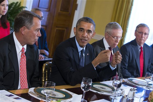 President Barack Obama meets with Congressional leaders in the Old Family Dining Room of the White House in Washington, Friday, Nov. 7, 2014. From left are, House Speaker John Boehner of Ohio, Obama, Senate Majority Leader Harry Reid of Nev., and Senate Minority Leader Mitch McConnell of Ky. (AP Photo/Evan Vucci)