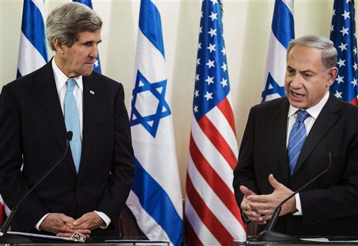In this Jan. 2, 2014 file photo, U.S. Secretary of State John Kerry, left, listens as Israeli Prime Minister Benjamin Netanyahu makes a statement during a press conference before their talk at the prime minister's office in Jerusalem. 2014 has been a difficult year for Israelis and Palestinians, with the failure of peace talks and a string of violent incidents that shows no signs of ending. (AP Photo/Brendan Smialowski, Pool, File)