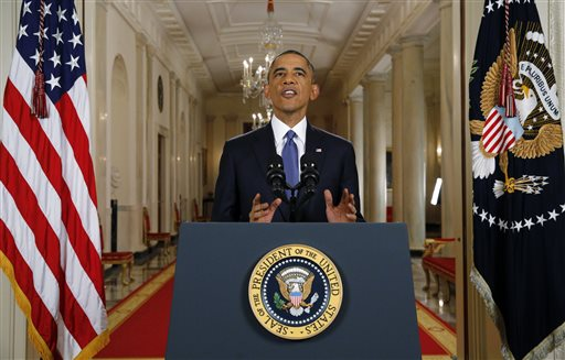 President Barack Obama announces executive actions on immigration during a nationally televised address from the White House in Washington, Thursday, Nov. 20, 2014. Obama outlined a plan on Thursday to relax U.S. immigration policy, affecting as many as 5 million people. (AP Photo/Jim Bourg, Pool)