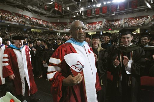 In this May 12, 2011 file photo, comedian Bill Cosby appears at Temple University's commencement in Philadelphia. Temple University says Cosby remains a trustee of the Philadelphia institution despite renewed scrutiny of sexual assault allegations against him. At least three women have publicly discussed their allegations against Cosby in recent weeks. Through his lawyer, the 77-year-old comedian has strongly denied wrongdoing. Cosby has never been charged. (AP Photo/Matt Rourke, File)