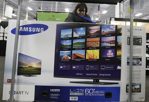 Leticia Garcia from Chicago, checks out a smart television at Best Buy on Thursday, Nov. 27, 2014, in Northbrook, Ill. Early-bird shoppers headed to stores on Thanksgiving in what's becoming a new holiday tradition. (AP Photo/Nam Y. Huh)