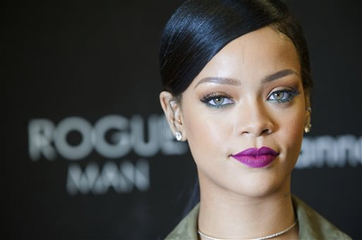Rihanna is photographed during an event promoting Rogue Man at Ft. Belvoir Exchange on Wednesday, Nov. 12, 2014 in Ft. Belvoir, Va. (AP Photo/Kevin Wolf)