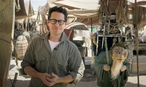 "In this video grab made available by Lucasfilm Ltd. & TM on Thursday, May 22,  2014, J.J. Abrams, director of ""Star Wars: Episode VII,"" talks to the fans from the movie set in the desert in Abu Dhabi, United Arab Emirates. Walt Disney Pictures announced Thursday, Nov. 6, that the movie previously known only as ""Episode VII"" has been dubbed ""The Force Awakens."" Disney also said that principle photography has wrapped on the J.J. Abrams-directed sequel six months after beginning. The film will be released in December 2015. (AP Photo/Lucasfilm Ltd., File)"