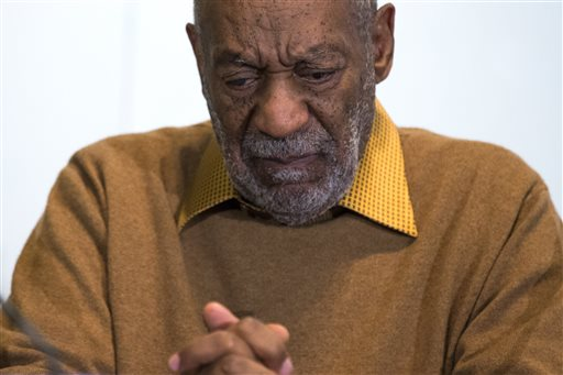 "In this Nov. 6, 2014 file photo, entertainer Bill Cosby pauses during a news conference. Cosby's attorney said Sunday, Nov. 16, 2014 that Cosby will not dignify ""decade-old, discredited"" claims of sexual abuse with a response, the first reaction from the comedian to an increasing uproar over allegations that he sexually assaulted several women in the past.  (AP Photo/Evan Vucci, File)"