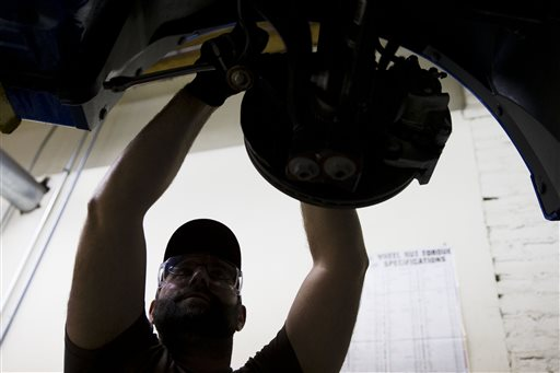 In this Oct. 23, 2014 photo, an automotive service technology student works on a car at the Community College of Philadelphia Thursday, Oct. 23, 2014, in Philadelphia. The Labor Department releases employment data for October on Friday, Nov. 7, 2014. (AP Photo/Matt Rourke)