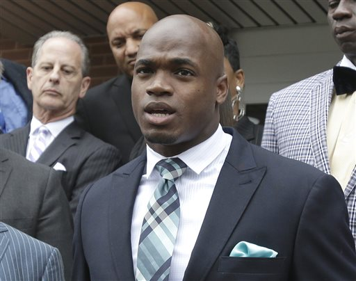 In this Nov. 4, 2014, file photo, Minnesota Vikings running back Adrian Peterson speaks to the media after pleading no contest to an assault charge in Conroe, Texas. Peterson will meet with the NFL on Monday, Nov. 17, 2014,  about possible reinstatement with the Vikings. A person with knowledge of the hearing told The Associated Press on Thursday, Nov. 13, that the hearing will be at 2 p.m. EST. The person spoke on condition of anonymity because the hearing has not been announced. (AP Photo/Pat Sullivan, File)