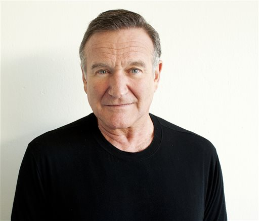 """In this Nov. 5, 2011 file photo, actor Robin Williams poses for a portrait during the """"Happy Feet"""" Press Junket in Beverly Hills, Calif. Authorities say an autopsy on Williams found no alcohol or illegal drugs in his system when he committed suicide at his Northern California home in August 2014. The Marin County sheriff's office released the autopsy results Friday, Nov. 7, 2014.  (Photo by Dan Steinberg/Invision/AP)"""