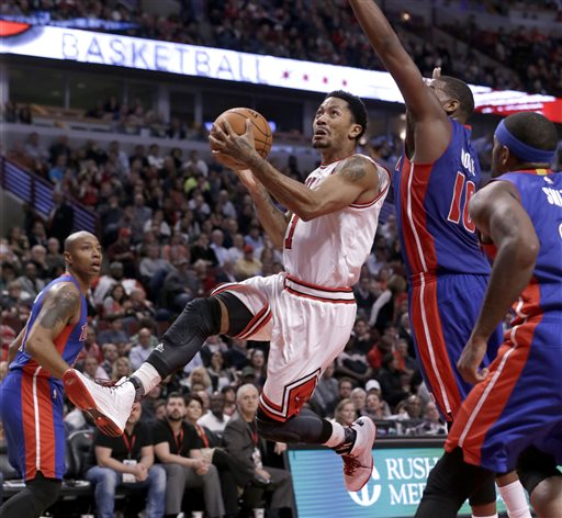 Chicago Bulls guard Derrick Rose drives past Detroit Pistons forward Greg Monroe (10) during the second half of an NBA basketball game Monday, Nov. 10, 2014, in Chicago. The Bulls won 102-91. (AP Photo/Charles Rex Arbogast)