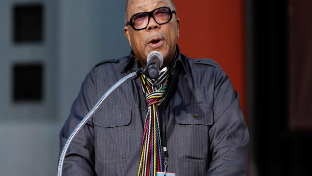 """Music producer Quincy Jones speaks during the hand and footprint ceremony honoring musician Michael Jackson in front of Grauman's Chinese Theatre in Los Angeles, Thursday, Jan. 26, 2012. The ceremony was held to celebrate the """"Michael Jackson The Immortal World Tour"""" by Cirque du Soleil. (AP Photo/Matt Sayles)"""