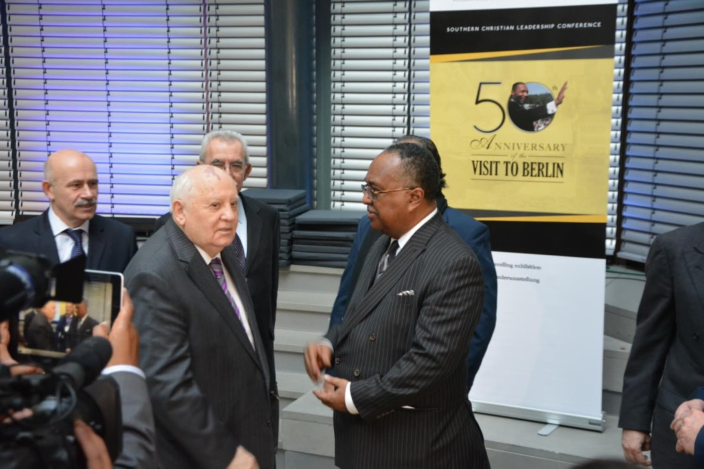 SCLC President Charles Steele with former Soviet President Gorbachev at the Symposium of the New Policy Forum in Berlin. They are standing in front of the SCLC banner of Dr. King's visit to Berlin 50 years ago. (Photoby Dieter Bölke)