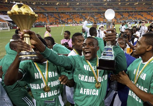 "This is a Sunday, Feb. 10, 2013 file photo of Nigeria's Emmanuel Emenike as he holds the trophy after they defeated Burkina Faso in the final to win the African Cup of Nations at the Soccer City Stadium in Johannesburg, South Africa. Morocco has been disqualified from the 2015 African Cup of Nations after refusing to host the tournament because of Ebola, and a new host country will be chosen. The Confederation of African Football said Tuesday Nov. 11, 2014 it has received ""some applications"" from possible replacement hosts. CAF didn't announce who the candidates were. (AP Photo/Armando Franca, File)"