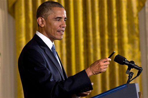 "President Barack Obama holds up a pen that he used to take notes during a reporter's multi-part question during a news conference in the East Room of the White House, Wednesday, Nov. 5, 2014, in Washington. Obama is telling Americans who voted for change: ""I hear you."" The President said the Republican victories Tuesday in the midterm elections are a sign they want Washington ""to get the job done."" (AP Photo/Jacquelyn Martin)"