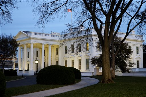 The White House is seen at dusk in Washington, Wednesday, Nov. 19, 2014. President Barack Obama on Thursday is expected to announce steps he will take to shield up to 5 million immigrants illegally in the United States from deportation. (AP Photo/Jacquelyn Martin)
