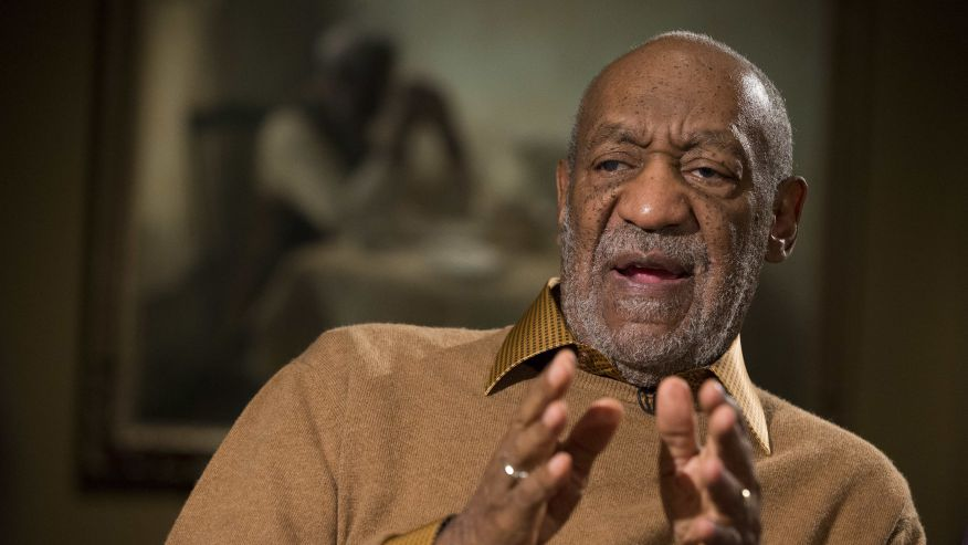 "Bill Cosby gesturing during an interview about the upcoming exhibit, ""Conversations: African and African-American Artworks in Dialogue"", at the Smithsonian's National Museum of African Art in Washington. (AP Photo)"