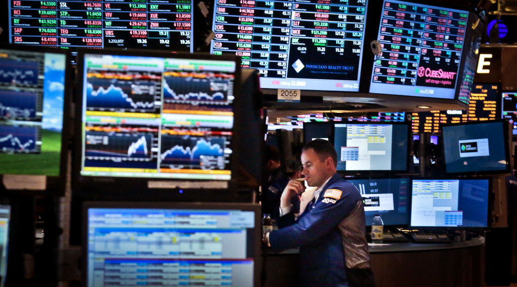Jason Hardzewicz, a floor official and trader for Barclays, works at his post on the floor of the New York Stock Exchange, Friday, Aug. 30, 2013, in New York. (AP Photo/Bebeto Matthews)
