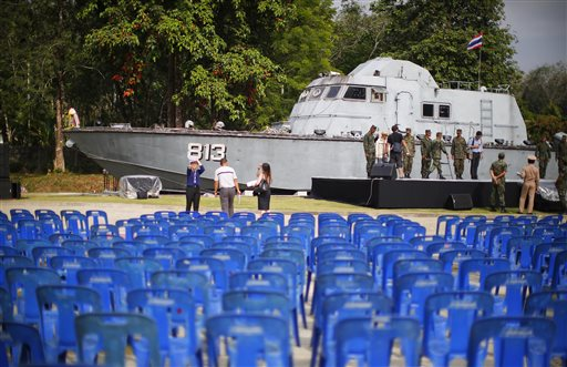 Thai military personnel and volunteers prepare for a memorial service to be held the next day in front of a police boat which was beached 10 years ago when the Asian tsunami struck, in Khao Lak, Thailand,  Thursday, Dec. 25, 2014. Dec. 26 marks the 10th anniversary of one of the deadliest natural disasters in world history: a tsunami, triggered by a massive earthquake off the Indonesian coast, that left more than 230,000 people dead in 14 countries and caused about $10 billion in damage. (AP Photo/Wong Maye-E)