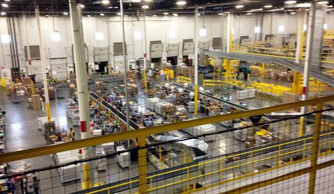 One of Amazon's newest distribution centers in Tracy, Calif., is seen during a tour Sunday, Nov. 30, 2014. This Amazon Fulfillment Center opened in 2013 and was refitted to use new robot technology in the summer of 2014. All year Amazon has been investing in ways to make shipping faster and easier to prepare for this holiday season. At this Northern California warehouse the company is employing robotics and other new technology to help workers process the annual onslaught of shopping orders. (AP Photo/Brandon Bailey)