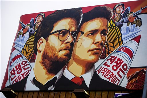 """A banner for """"The Interview"""" is posted outside Arclight Cinemas, Wednesday, Dec. 17, 2014, in the Hollywood section of Los Angeles. A U.S. official says North Korea perpetrated the unprecedented act of cyberwarfare against Sony Pictures that exposed tens of thousands of sensitive documents and escalated to threats of terrorist attacks that ultimately drove the studio to cancel all release plans for """"The Interview."""" (AP Photo/Damian Dovarganes)"""
