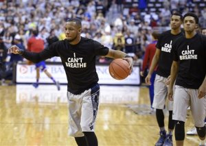 """Georgetown guard Jabril Trawick, left,  wears an """"I Can't Breathe"""" t-shirt during warm ups before NCAA college basketball game against Kansas, Wednesday, Dec. 10, 2014, in Washington. (AP Photo/Nick Wass)"""