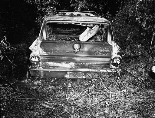 This June 1964 FBI photograph presented into evidence, Friday, June 17, 2005, in Philadelphia, Miss., during the trial of Edgar Ray Killen, who is charged with the 1964 deaths of three civil rights workers. The photograph shows the burned station wagon driven by James Chaney, Andrew Goodman and Mickey Schwerner was found shortly after their disappearance. The car was discovered at the Bogue Chitto swamp some 13 miles northeast of Philadelphia.   (AP Photo/State of Mississippi, Attorney General's Office, File)
