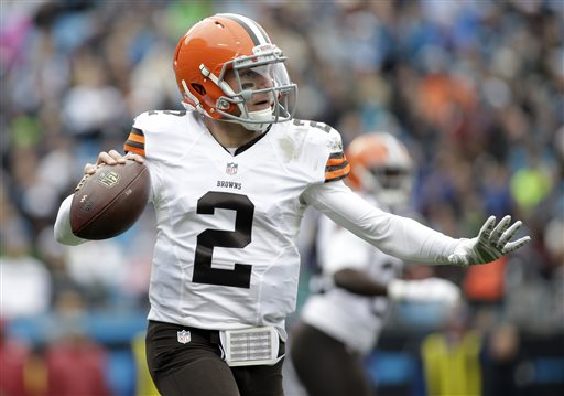 Cleveland Browns' Johnny Manziel (2) looks to pass against the Carolina Panthers in the first half of an NFL football game in Charlotte, N.C., Sunday, Dec. 21, 2014. (AP Photo/Bob Leverone)