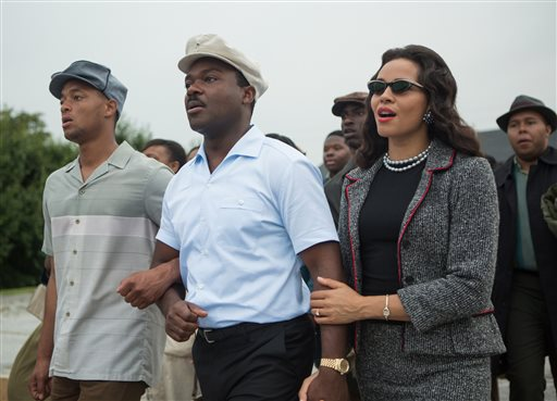 "This photo released by Paramount Pictures shows, David Oyelowo, center, as Martin Luther King, Jr. and Carmen Ejogo, right, as Coretta Scott King in the film, ""Selma,"" from Paramount Pictures and Pathé. The Civil Rights march drama is up for eight NAACP Image Awards honoring diversity in the arts, including outstanding motion picture; lead actor for David Oyelowo; supporting actor for Andre Holland, Common and Wendell Pierce; supporting actress for Carmen Ejogo and Oprah Winfrey; and director for Ava DuVernay. The awards will be presented in a Feb. 6 ceremony airing on the TV One channel. (AP Photo/Paramount Pictures, Atsushi Nishijima)"