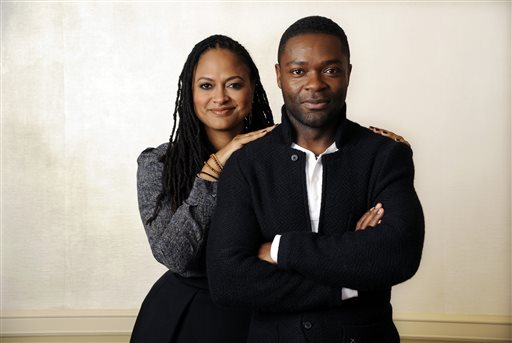 "FILE - In this Wednesday, Nov. 12, 2014 file photo, Ava DuVernay, left, director of the film ""Selma,"" and cast member, David Oyelowo, who plays Martin Luther King Jr., pose together at the Four Seasons Hotel in Los Angeles.  The widely acclaimed movie ""Selma"" about the 1965 Civil Rights movement has disappointed at least one moviegoer: a leading historian of President Lyndon B. Johnson. The director of the LBJ Presidential Library in Austin, which hosted a major civil rights summit this year that was headlined by four U.S. presidents, said the film that opens in theaters Thursday, Dec. 25, 2014, incorrectly portrays Johnson as an obstructionist to the Rev. Dr. Martin Luther King Jr. (Photo by Chris Pizzello/Invision/AP)"