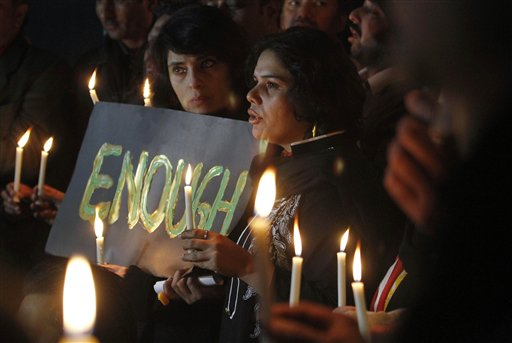 "Pakistani civil society members take part in a candle light vigil for the victims of a school attacked by the Taliban in Peshawar, Tuesday, Dec. 16, 2014 in Islamabad, Pakistan. British Prime Minister David Cameron issued a statement in response to the attack that killed more than 100, most of them children: ""The scale of what has happened in Pakistan simply defies belief. It is a dark, dark day for humanity when something on this scale happens with no justification."" (AP Photo/Anjum Naveed)"