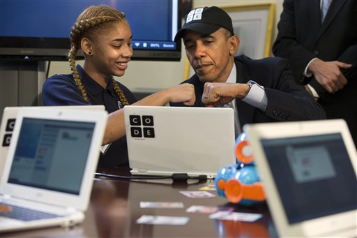 "President Barack Obama does a ""fist bump"" with a Adrianna Mitchell during an ""Hour of Code"" event in the Eisenhower Executive Office Building on the White House complex in Washington, Monday, Dec. 8, 2014, attended by  middle-school students from Newark, N.J. (AP Photo/Jacquelyn Martin)"
