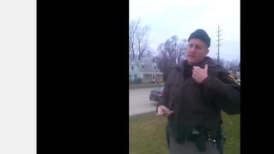 Photo of Man, Cop Film Stop for Walking with Hands in Pockets